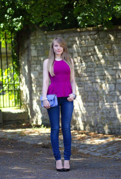 purple peplum top with blue skinny jeans and black heels