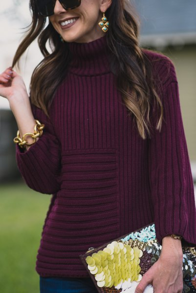 purple turtleneck knit sweater with black and yellow clutch bag