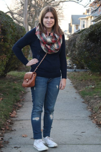 red and white plaid scarf and blue jeans