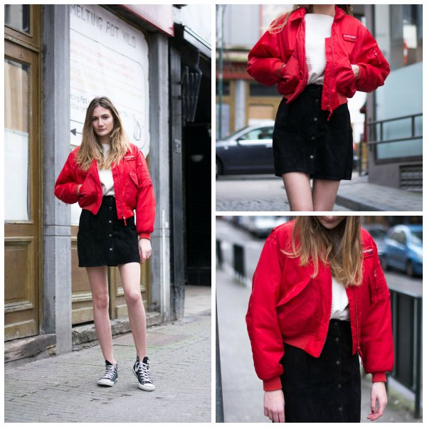 red bomber jacket with black button front denim mini skirt