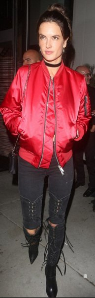 red bomber jacket with black ripped skinny jeans
