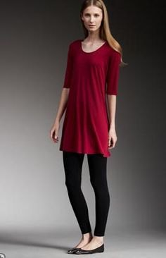 red half sleeve tunic with black leggings and flats