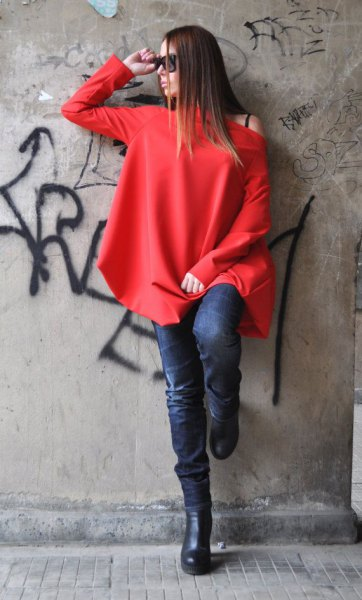 red long sleeve one shoulder top with dark blue skinny jeans