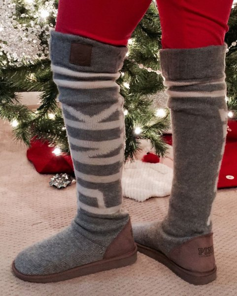 red skinny jeans with grey thigh high boots