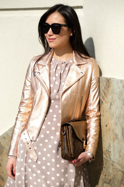 rose gold jacket with grey and white polka dot dress