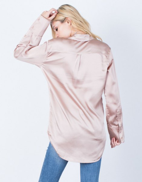 rose gold oversized button up silk shirt with blue jeans