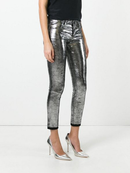 shiny silver cropped jeans with black sleeveless top