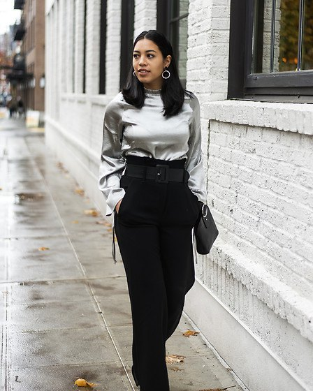 silver metallic blouse with black high waisted wide leg pants