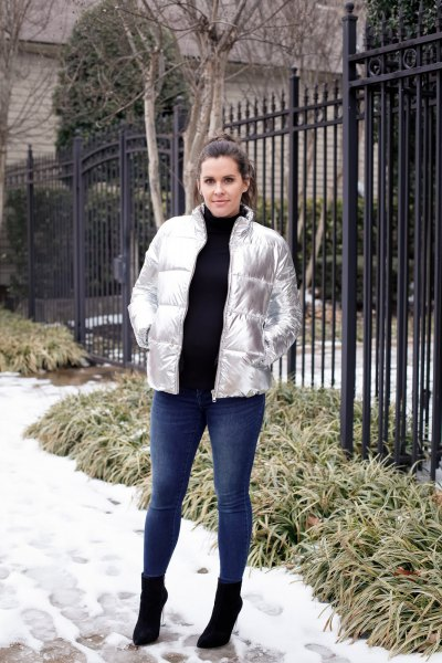 silver metallic down jacket with black turtleneck sweater