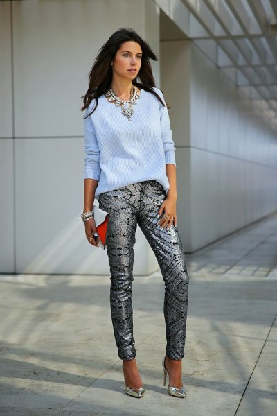 sky blue fitted knit sweater with black and silver tribal printed jeans
