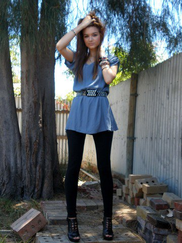 teal blue peplum top with black studded belt and leggings