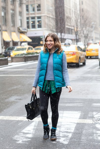 teal sweater with sky blue vest and black leggings