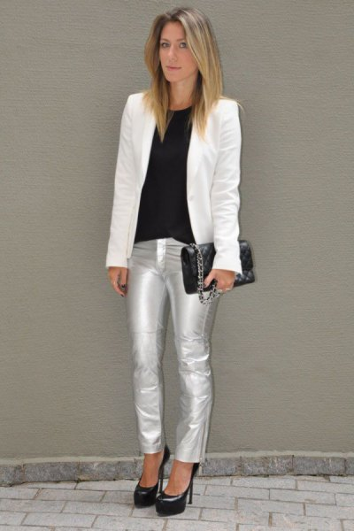 white blazer with black crew neck top and silver metallic jeans