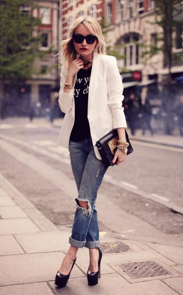 white blazer with black print tee and ripped jeans