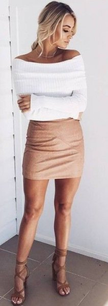 white boat neck form fitting ribbed sweater with mini bodycon skirt