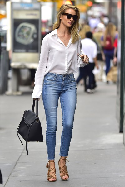 white button up silk blouse with light blue skinny jeans