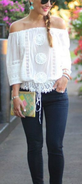 white crochet lace off the shoulder top with skinny jeans