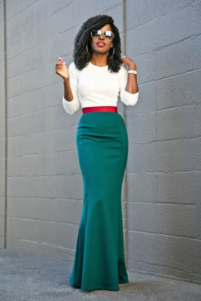white cropped sweater with grey floor length skirt
