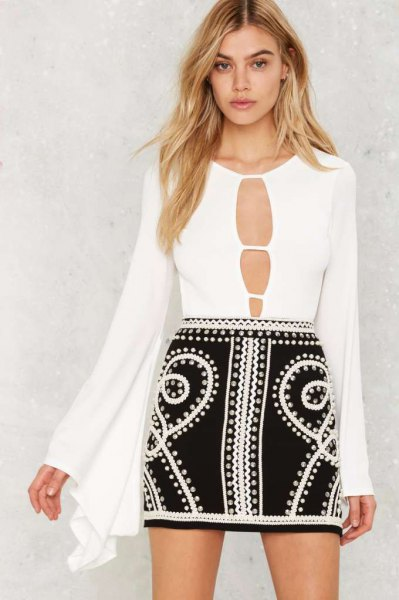 white cutout front bell sleeve bodysuit blouse with black mini skirt
