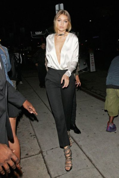 white deep v neck silk blouse with black wide leg cropped pants
