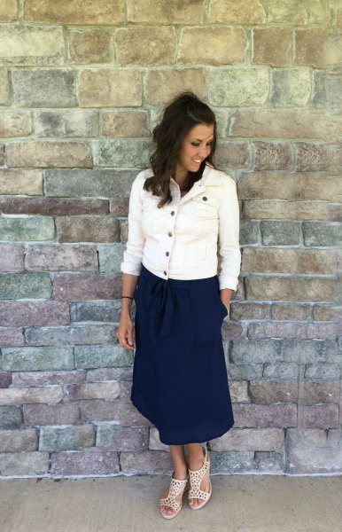 white denim button up jacket with navy midi relaxed fit skirt