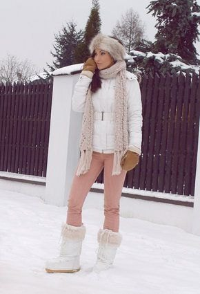 white down jacket with light grey knit scarf and faux fur snow boots