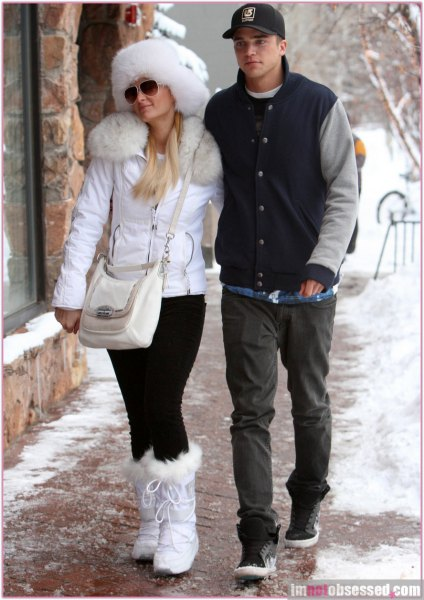 white faux fur collar coat with matching snow boots