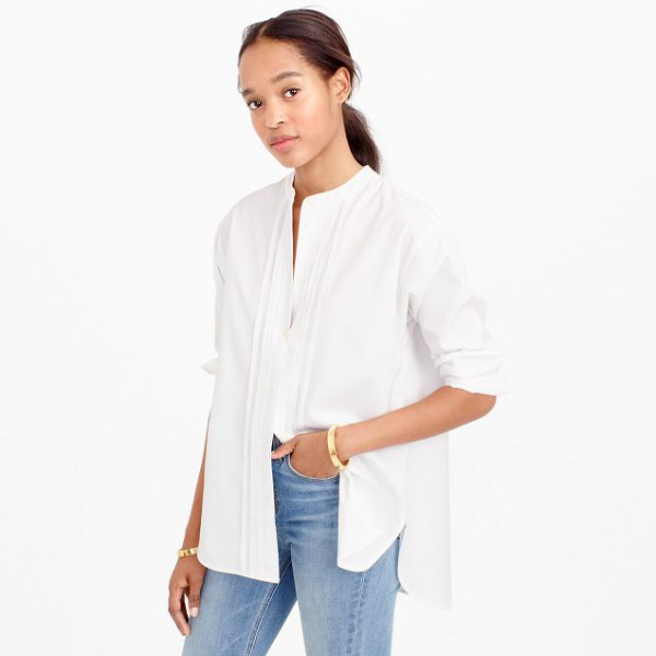 white half sleeve oversized collar less shirt with blue jeans