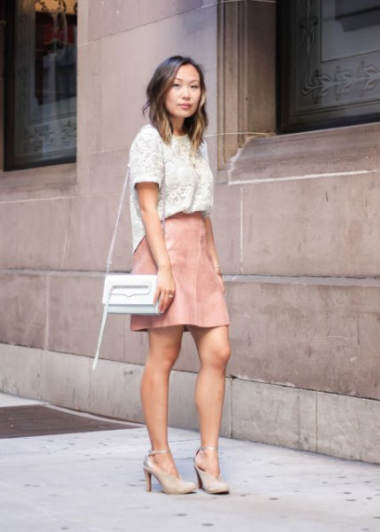 white lace short sleeve top with pale pink leather mini skirt