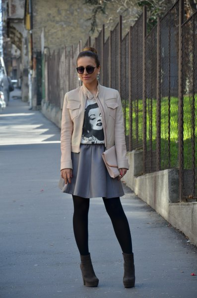 white leather jacket with grey mini skater skirt