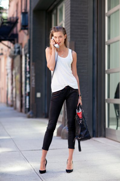 white long tank top with black cropped skinny jeans and ballet heels