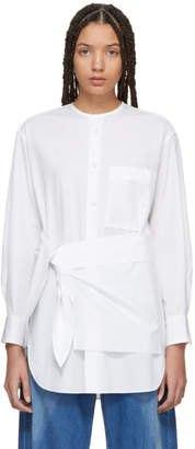 white long tie waist no collar dress shirt with blue wide leg jeans