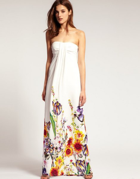 white maxi strapless dress with colorful floral printed details