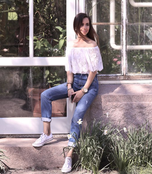 white off the shoulder lace top with cuffed jeans and sneakers