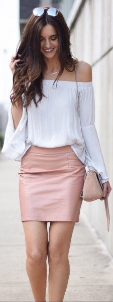 white off the shoulder wide sleeve blouse with mini leather blush skirt