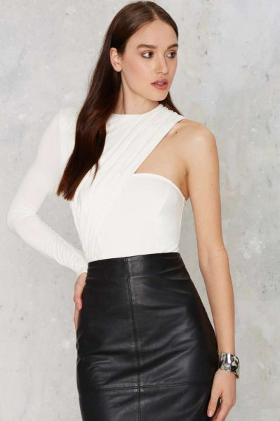 white one sleeve bodysuit blouse with black leather skirt