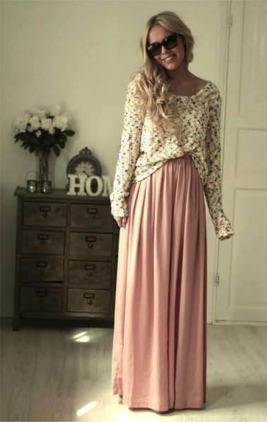 white patterned sweater with pink maxi skirt