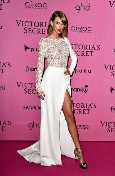 white semi sheer high split floor length dress with bronze strappy heels