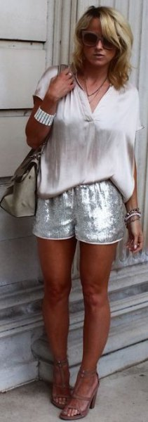 white short sleeve blouse with silver sequin shorts