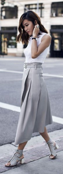 white sleeveless blouse with grey pleated midi skirt