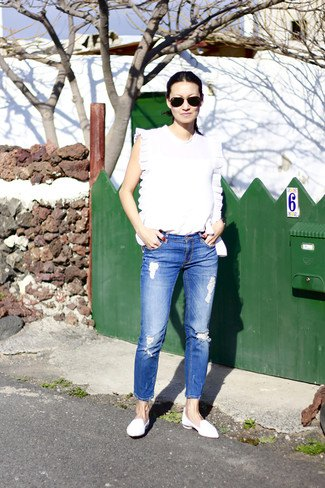 white sleeveless top with blue crop jeans and leather loafers