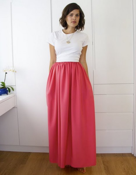 white t shirt with high waisted elastic waist maxi hot pink skirt