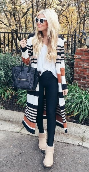 white t shirt with multi colored striped longline coat and snow boots