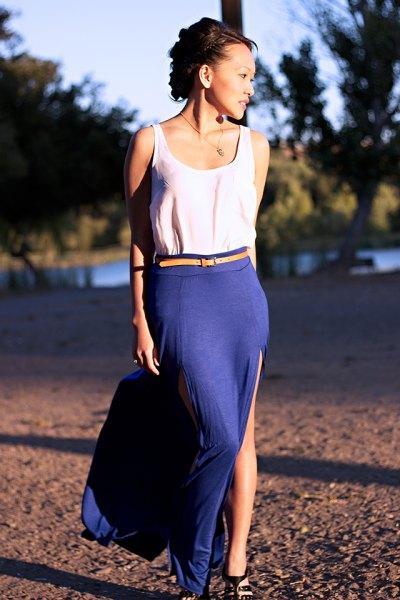white tank top with yellow belt and blue high split skirt