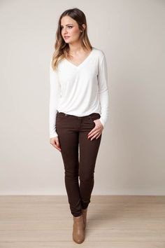 white v neck long sleeve tee with brown jeans and ankle boots