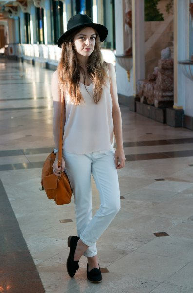 white v neck long tank top with matching chinos and felt hat