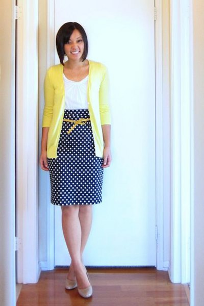 yellow cardigan with white vest top and polka dot midi skirt