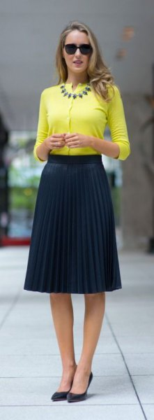 yellow half sleeve no collar blouse with pleated midi navy skirt