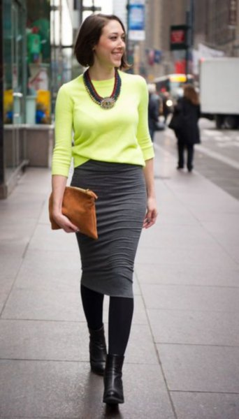 yellow knit sweater with grey midi skirt
