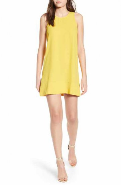 yellow mini tank shift dress with silver heels